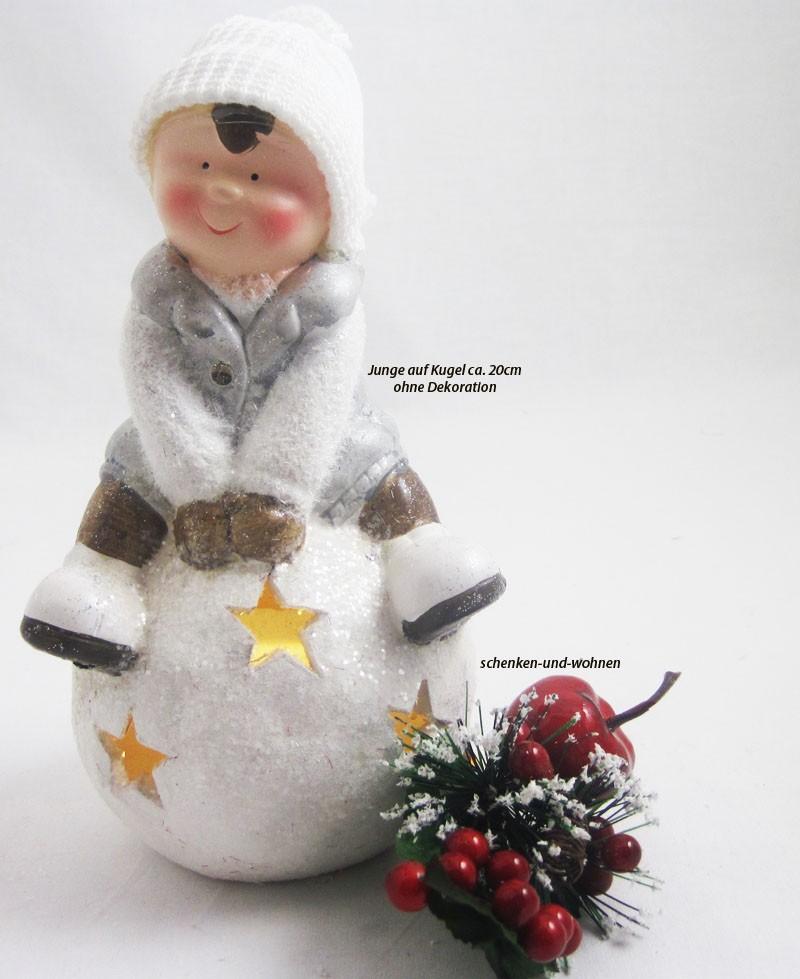 1 Winterkind Junge auf LED-Schneekugel, weiß  Höhe ca. 20 cm