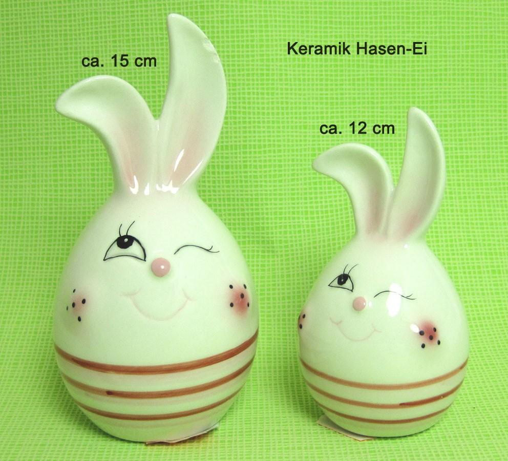 Keramik Deko-Ei ca. 12 cm mit roten Streifen und Hasengesicht