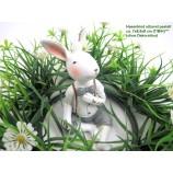 1 Hasenkind - Junge sitzend, pastell grau/rosa/weiß ca.7 x 6,5 x 9cm (T/B/H)